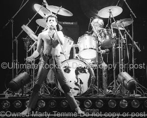 Photo of Freddie Mercury and Roger Taylor of Queen onstage in 1980 by Marty Temme