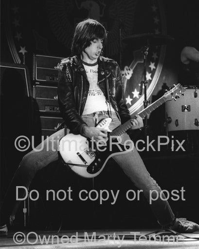 Photo of guitarist Johnny Ramone of The Ramones in concert in 1979 by Marty Temme