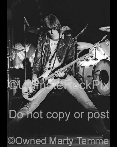 Photo of guitar player Johnny Ramone of The Ramones in concert in 1979 by Marty Temme