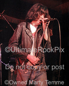 Photo of Joey Ramone of The Ramones in concert in 1978 by Marty Temme