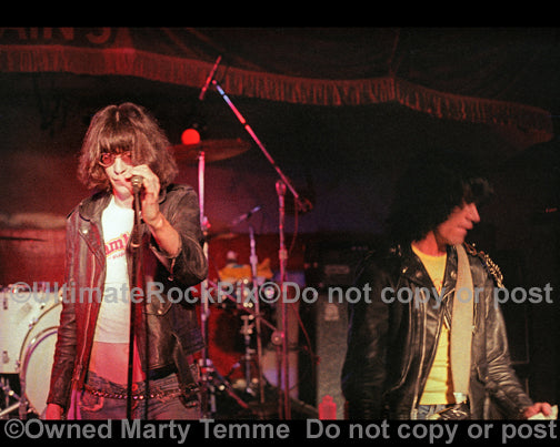 Photo of Joey and Dee Dee Ramone of The Ramones in concert in 1978 by Marty Temme