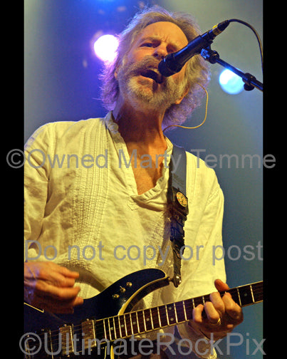 Photo of guitar player Bob Weir of RatDog and The Grateful Dead playing a Modulus guitar in concert by Marty Temme
