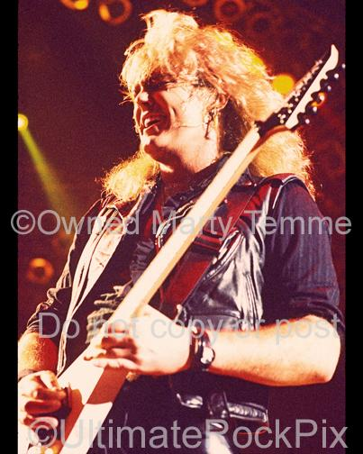 Photos of Guitarist Robbin Crosby of Ratt in Concert by Marty Temme