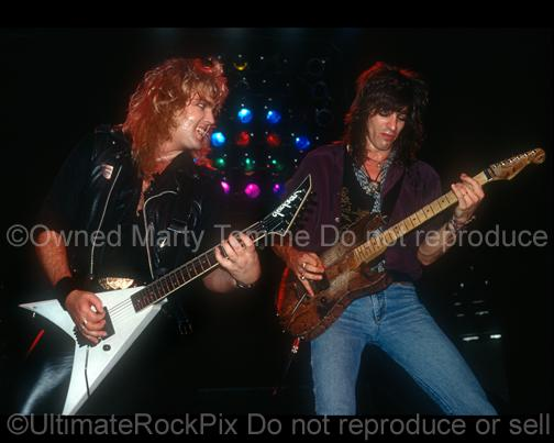 Photos of Guitar Players Robbin Crosby and Warren DeMartini of Ratt Playing Together Onstage in 1988 by Marty Temme
