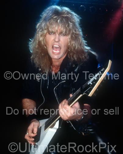 Photos of Robbin Crosby of Ratt Playing a Charvel Jackson Guitar in Concert in 1988 by Marty Temme