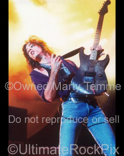 Photo of guitarist Warren DeMartini of Ratt playing onstage in 1989 in Los Angeles, California by Marty Temme