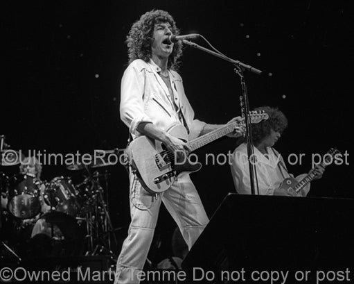 Photo of Kevin Cronin of REO Speedwagon in concert in 1981 by Marty Temme
