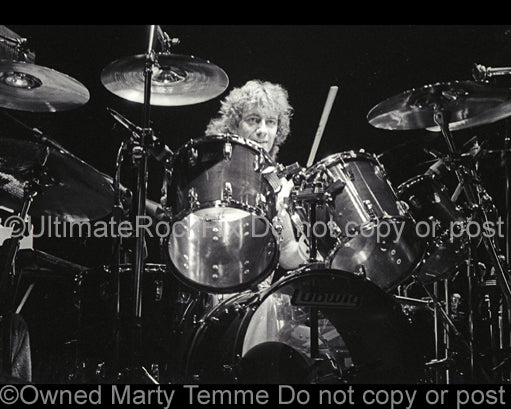 Photo of Alan Gratzer of REO Speedwagon in concert in 1981 by Marty Temme