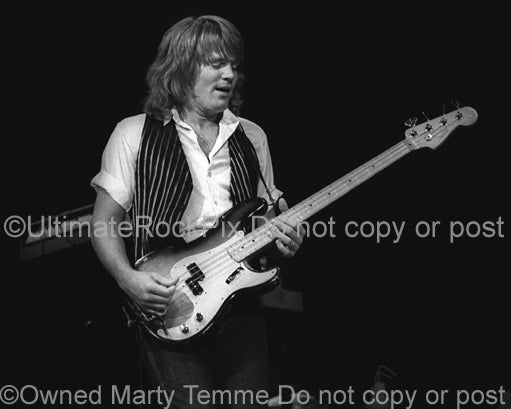 Photo of bass player Bruce Hall of REO Speedwagon in concert in 1981 by Marty Temme