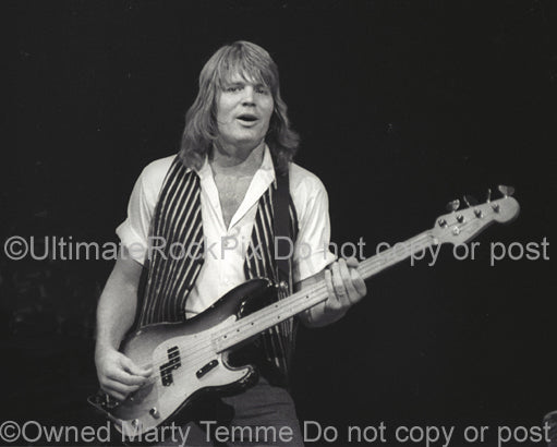 Photo of Bruce Hall of REO Speedwagon in concert in 1981 by Marty Temme