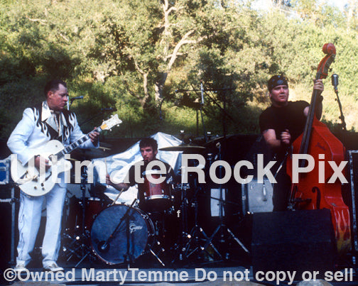 Photo of Jim Heath, Jimbo Wallace and Scott Churilla of The Reverend Horton Heat in concert by Marty Temme