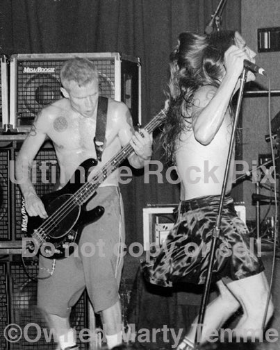 Photo of Flea and Anthony Kiedis of The Red Hot Chili Peppers onstage in 1994 by Marty Temme