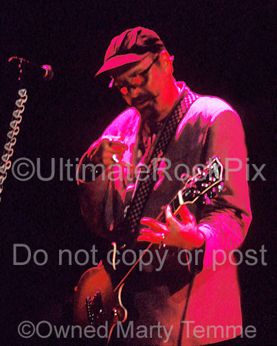 Photo of Rick Nielsen of Cheap Trick playing a Gretsch guitar in concert in 1997 by Marty Temme