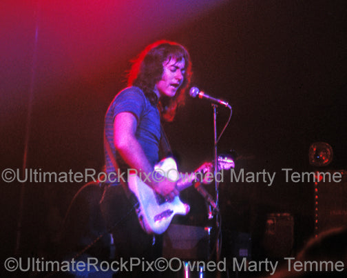 Photo of Rory Gallagher playing his Telecaster in concert in 1973 by Marty Temme