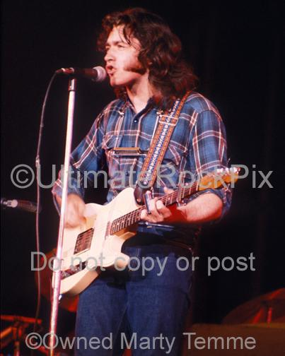 Photos of Guitar Player Rory Gallagher Playing his Fender Telecaster in Concert in 1973 by Marty Temme