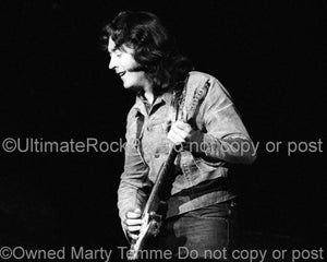 Photo of blues guitar player Rory Gallagher playing his Fender Strat in 1973 by Marty Temme