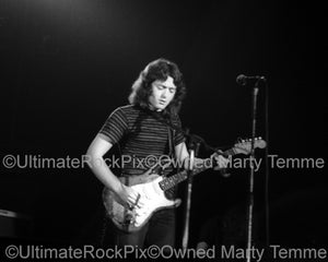 Black and white photo of Rory Gallagher playing his Stratocaster in 1973 by Marty Temme