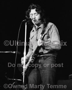 Photo of blues guitar player Rory Gallagher playing his Fender Stratocaster in 1973 by Marty Temme