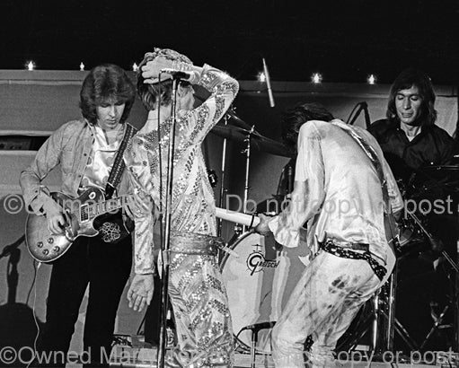Photo of Mick Taylor, Mick Jagger, Keith Richards and Charlie Watts of The Rolling Stones in 1973 by Marty Temme