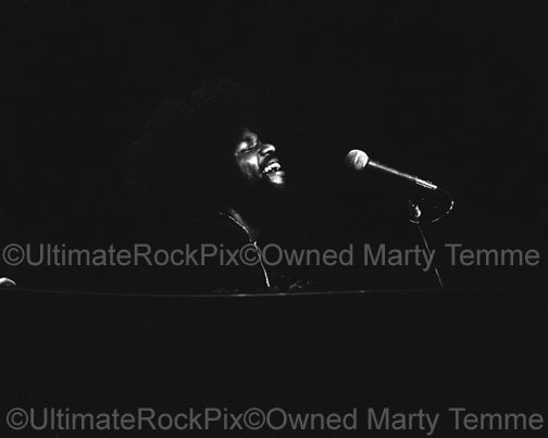 Photo of Billy Preston of The Rolling Stones playing piano in 1975 by Marty Temme