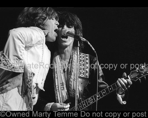 Photo of Mick Jagger and Keith Richards of The Rolling Stones in concert in 1975 by Marty Temme