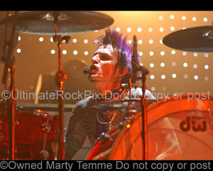 Photo of Tommy Lee of Motley Crue in concert by Marty Temme