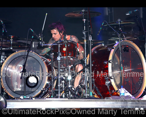 Photo of drummer Tommy Lee of Motley Crue in concert by Marty Temme