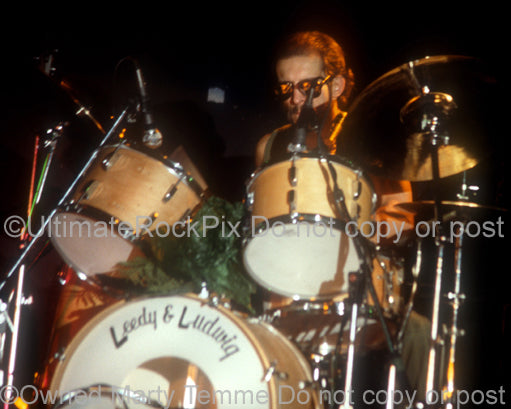 Photo of drummer Willie Wilcox of Todd Rundgren in concert in 1981 by Marty Temme