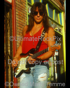 Photo of Richie Sambora with a Stratocaster during a photo shoot in 1991 by Marty Temme