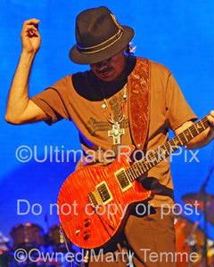 Photos of Carlos Santana of Santana Playing a PRS Guitar in Concert by Marty Temme
