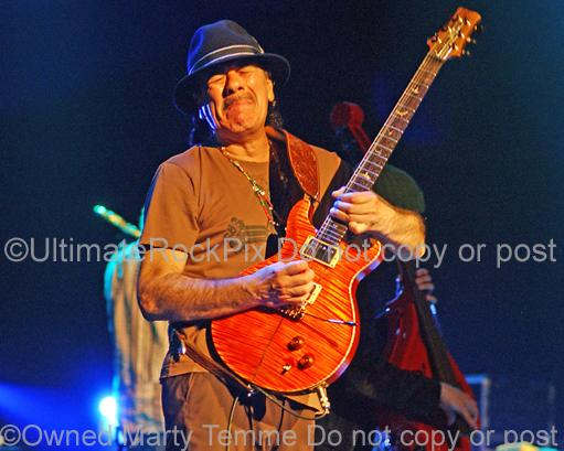 Photos of Guitarist Carlos Santana of Santana in Concert by Marty Temme