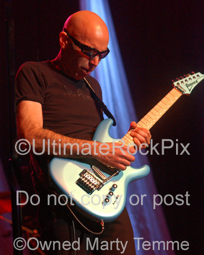 Photo of guitar player Joe Satriani in concert in 2010 by Marty Temme