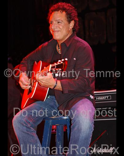 Photos of Neal Schon playing acoustic guitar in 2006 by Marty Temme