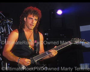 Photos of Neal Schon of Bad English Playing Guitar onstage at The Whisky in 1989 by Marty Temme