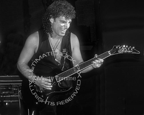 Black and white photo of Neal Schon of Bad English in concert in 1989 by Marty Temme