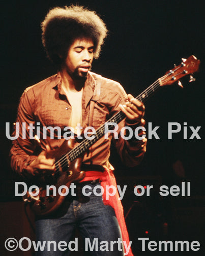 Photo of bassist Stanley Clarke of The New Barbarians in concert in 1979 by Marty Temme