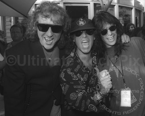 Photo of Herman Rarebell, Klaus Meine and Joe Leste in 1991 by Marty Temme