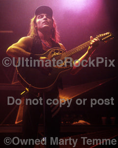 Photo of Matthias Jabs of Scorpions playing acoustic guitar in concert in 1991 by Marty Temme