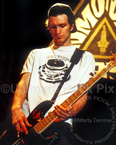 Photo of bass player Ben Shepherd of Soundgarden playing a black Fender Bass in concert in 1991 by Marty Temme