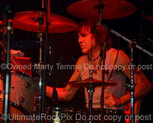 Photo of Sandy Gennaro of Pat Travers in concert in 2009 by Marty Temme