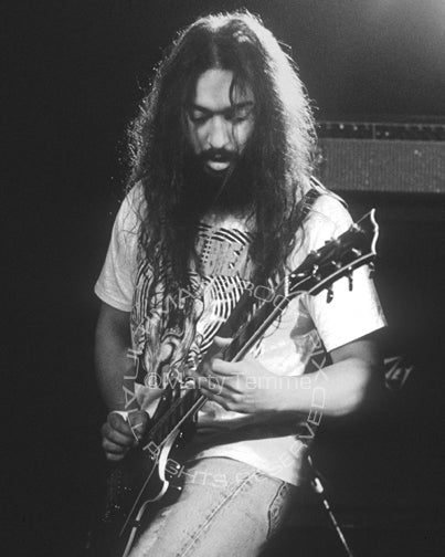 Black and white photo of Kim Thayil playing a black Les Paul in concert by Marty Temme