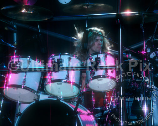 Photo of drummer Greg Ellis of Shark Island in concert in 1988 by Marty Temme