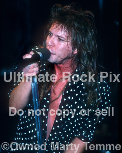 Photo of singer Richard Black of Shark Island performing in concert in 1988 by Marty Temme