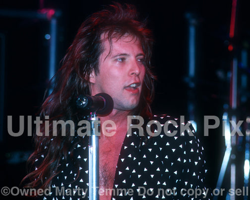 Photo of Richard Black of Shark Island performing in concert in 1988 by Marty Temme