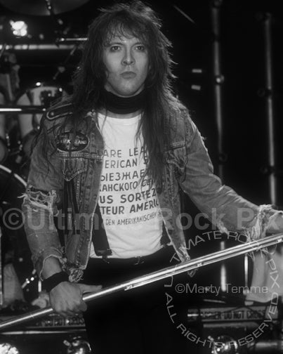 Black and white photo of Richard Black of Shark Island onstage in 1989