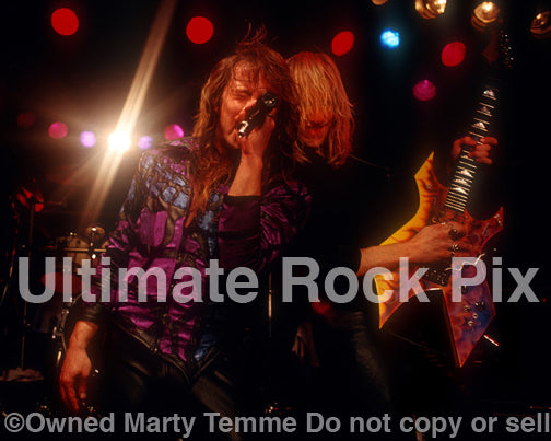 Photo of Richard Black and Spencer Sercombe of Shark Island performing onstage in 1989 by Marty Temme