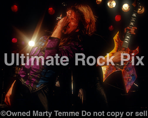 Photo of Richard Black and Spencer Sercombe of Shark Island onstage in 1989 by Marty Temme
