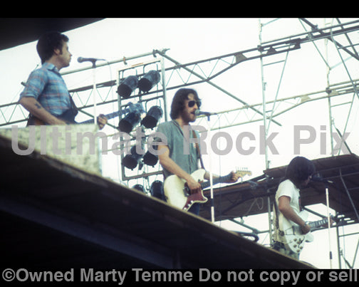 Photo of Richie Furay, Chris Hillman and J.D. Souther of Souther Hillman Furay Band in concert in 1974 by Marty Temme