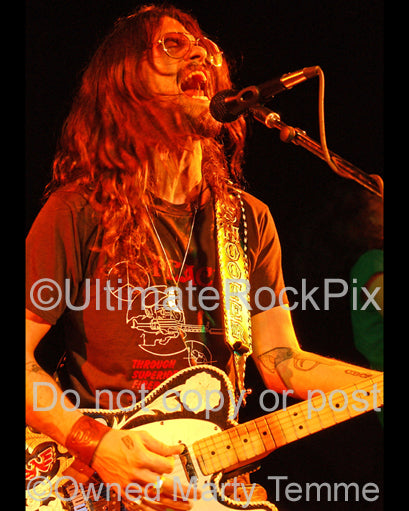 Photo of Shooter Jennings playing his Telecaster in concert by Marty Temme