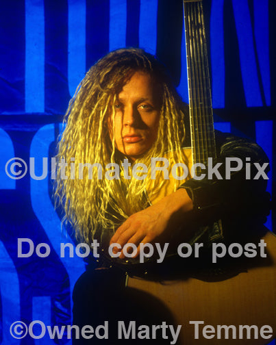 Photo of Tim Skold of Shotgun Messiah holding an acoustic guitar in 1992 by Marty Temme